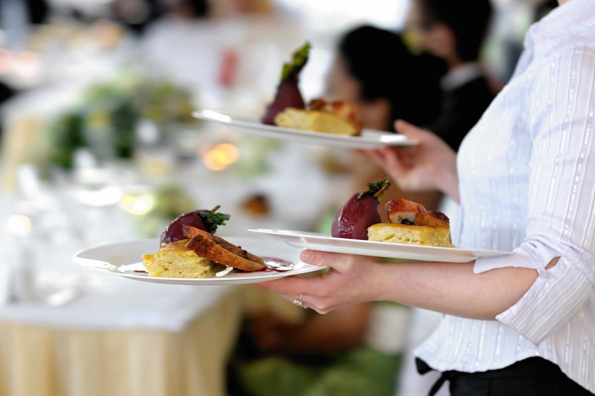 restaurant worker holding plates