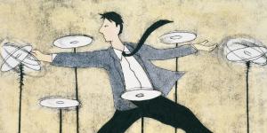Man balancing spinning plates.