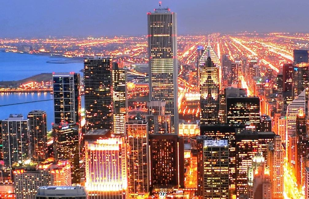 picture of city of chicago, showing the skyscrapers at night, lighted up the entire city